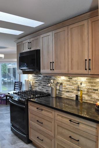 Kitchen with white cabinets and white walls.