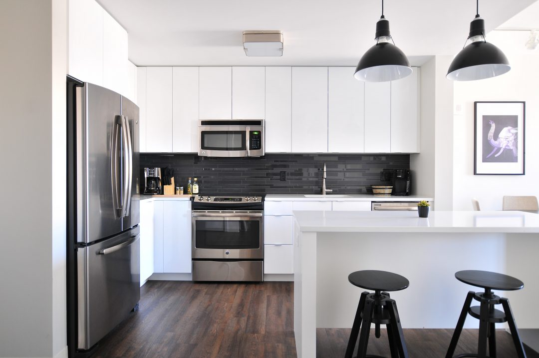 Pacific Slab White Thermofoil kitchen cabinets